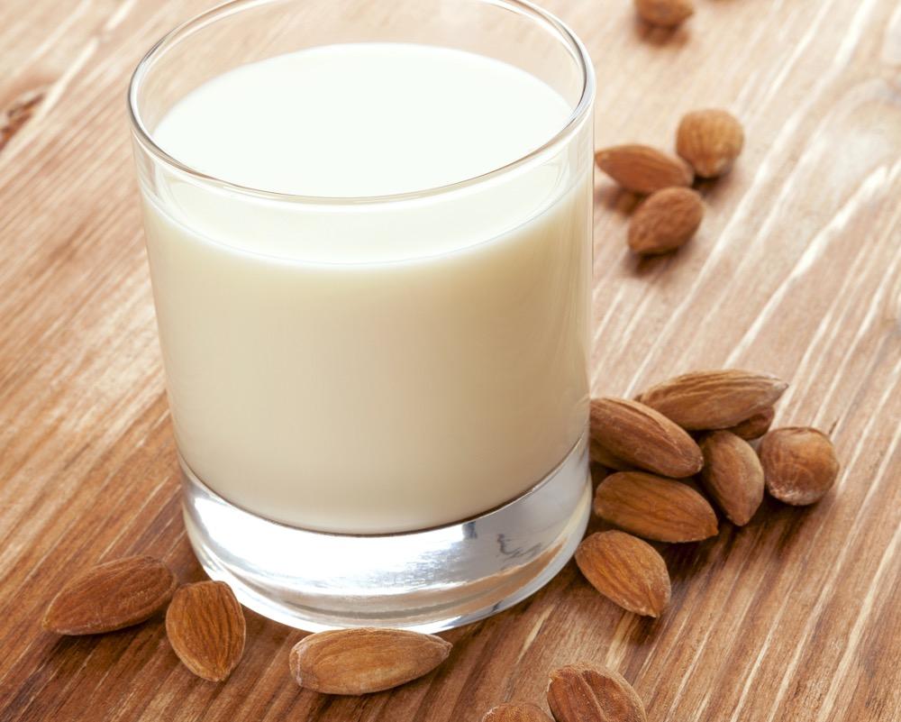 Delicious almond milk. Vegan milk drinking.
